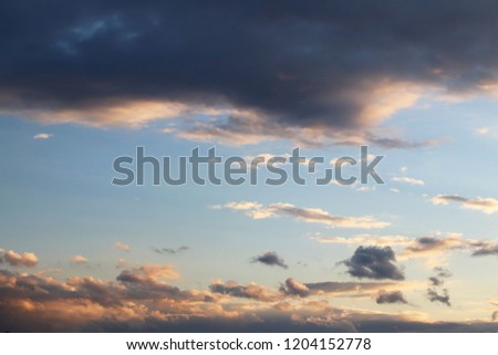 Cumulus in the evening sky in the rays of the setting sun. Romantic atmosphere. The water cycle in nature. Steam and gaseous state of the liquid. Weather and atmospheric phenomena #1204152778