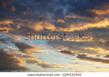 Cumulus in the evening sky in the rays of the setting sun. Romantic atmosphere. The water cycle in nature. Steam and gaseous state of the liquid. Weather and atmospheric phenomena #1204162966