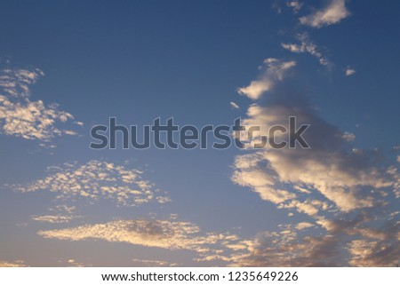 Cumulus in the evening sky in the rays of the setting sun. Romantic atmosphere. The water cycle in nature. Steam and gaseous state of the liquid. Weather and atmospheric phenomena #1235649226