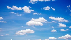 Cumulus white clouds floating in blue sky, concept for design to make wallpaper.