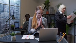Cunning young adult professional business woman company director rubbing hands, scheming evil tricky prank plan in mind, smiling in office interior. Clever girl robber pondering ominous revenge, cheat