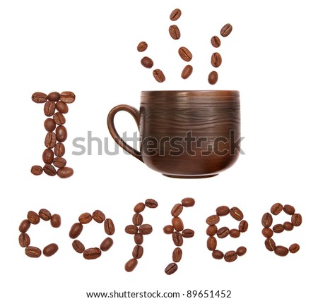 "Cup and coffee beans isolated on white, saying ""I drink coffe"""
