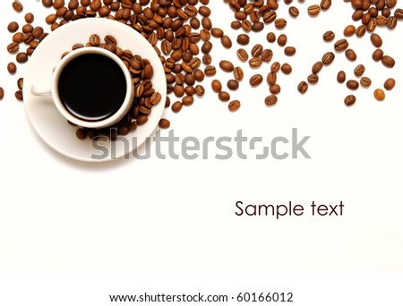 cup and coffee beans isolated over white background