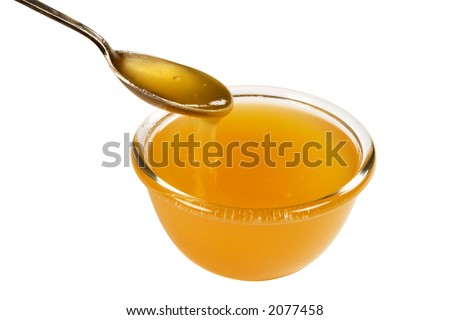 cup and spoonful of honey, isolated on white, clipping path included