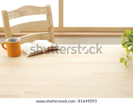 Cup book and plant on wooden table #81649093