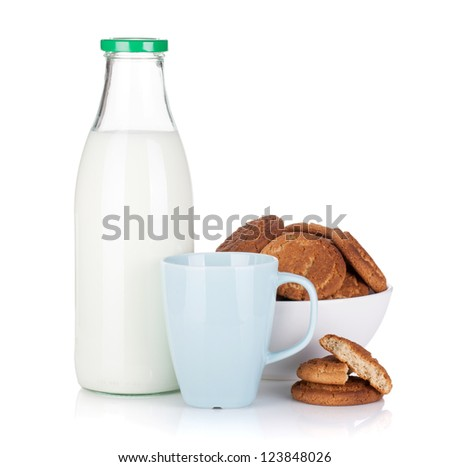 Cup, bottle of milk and bowl with cookies. Isolated on white background