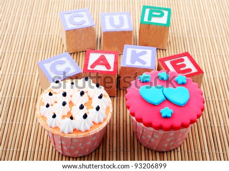 cup cake with word on bamboo mat - stock photo