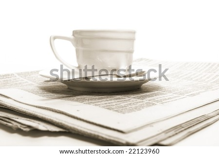 Cup  coffee on a morning paper business news