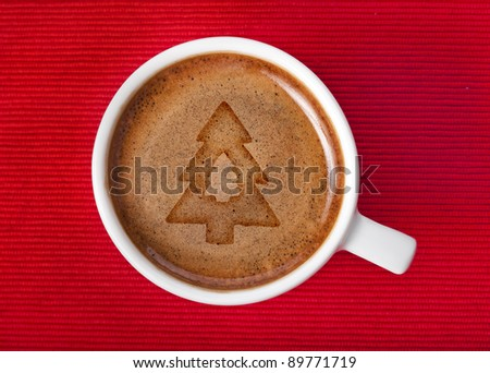 cup coffee with christmas tree on a red napkin background