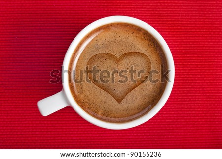 cup coffee with heart symbol on a red napkin background