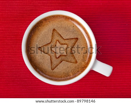 cup coffee with star on a red  background