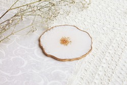 Cup holder, epoxy resin tray, marine-style stone cut. White stains of paint, gold trim. Subject for table setting.  Gloss, reflection. Epoxy resin coaster. Home decor