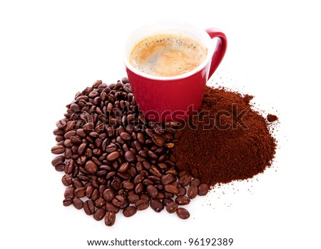 Cup in pile of roasted beans and regular ground coffee over white background - stock photo