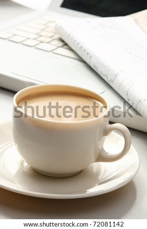 cup near the laptop