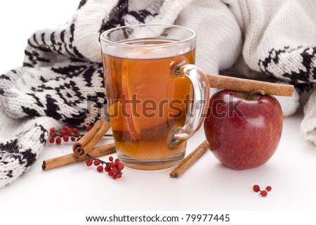 cup od apple cider and rolls of cinnamon