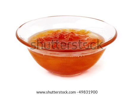 Cup of apricot marmalade on white background