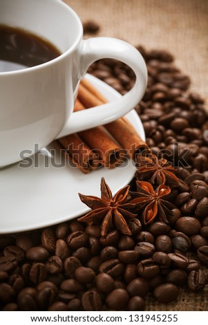 cup of aromatic coffee with cinnamon and anise star. still life