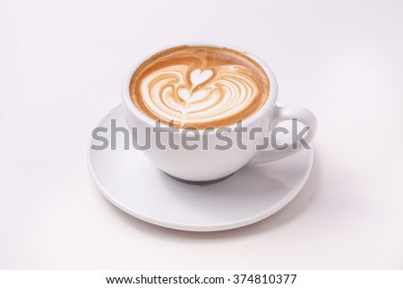 Cup of art latte on a cappuccino coffee isolated on white background
