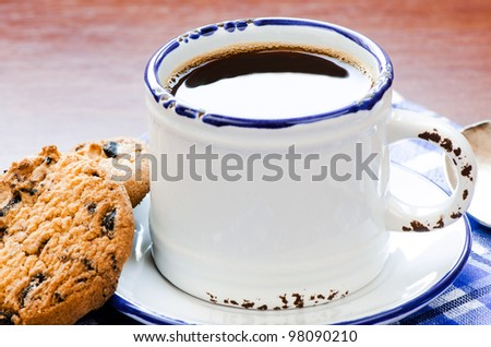 Cup of black cofee with cookie