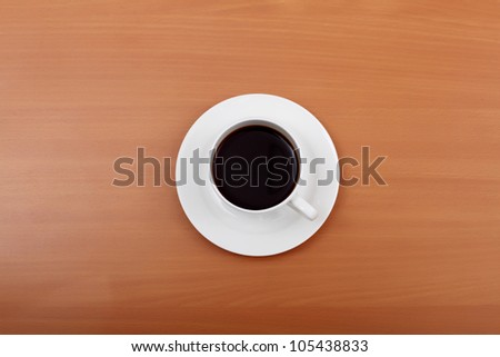 Cup of black coffee in a white cup