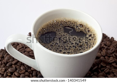 Cup of black coffee in a white mug