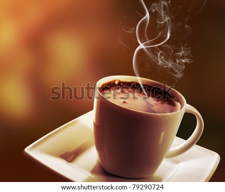 Cup of black coffee on dark background