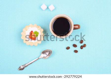 Cup of black coffee, sugar cubes and cake. Strawberry cake with cream. Dessert tart. Cream cake with strawberries, mint leaves. Breakfast, lunch and snack. Cafeteria and restaurant. Food and sweets.