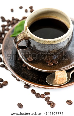 Cup of black coffee with beans on white background. Food and Drinks. Selective focus