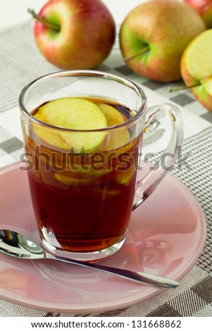 Cup of black tea with sliced apples for a healthy diet