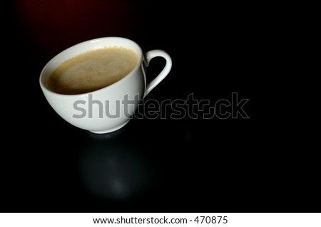 Cup of cafe latte on black table
