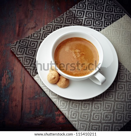 Cup of caffe crema with biscotti