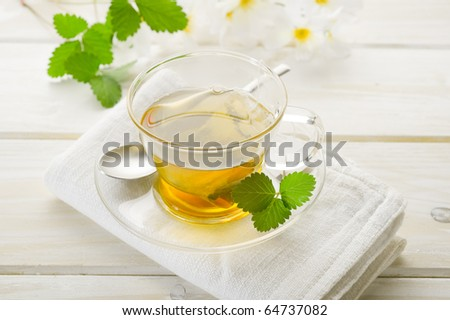 cup of camomile with leaf and flower