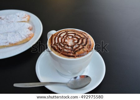 Cup of cappuccino and sweet cake on a black background  #492975580