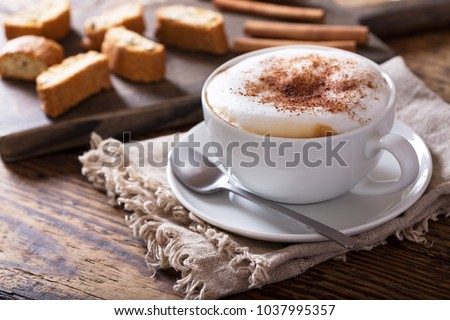 Cup of cappuccino coffee on wooden table #1037995357