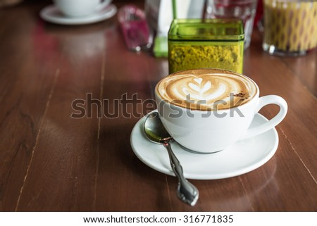 cup of cappuccino, cup of coffee, cup of coffee on brown wooden table