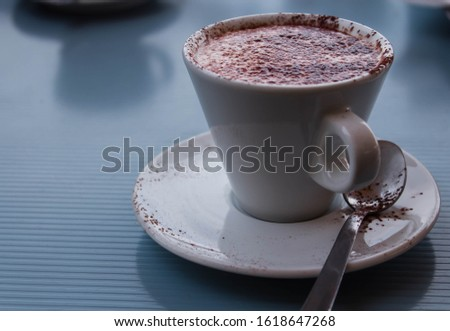 cup of cappuccino on the table