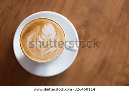 cup of cappuccino on the wooden table background