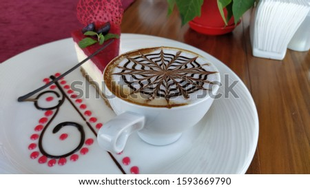 cup of cappuccino. white cup and cappuccino foam