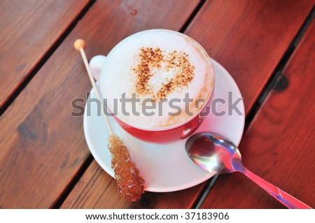 cup of cappuccino with choc heart over milk skin
