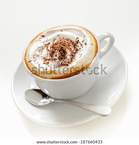 Cup of cappuccino with cream and chocolate