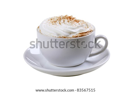 Cup of cappuccino with cream and nutmeg