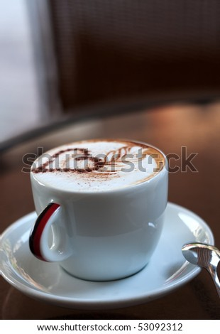 Cup of cappuccino with heart on foam - stock photo