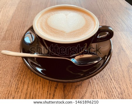 Cup of cappuccino with heart on the table #1461896210