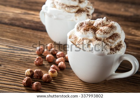 Cup Of Cappuccino With Whipeed Cream Over Wooden Table