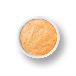 cup of chipotle ranch dressing isolated on a white background