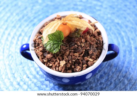 Cup of chocolate granola cereal
