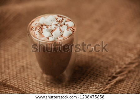 Cup of cocoa and marshmallows brown background  #1238475658