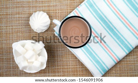 cup of cocoa on a wooden table, marshmallows and sugar flatlay #1546091906