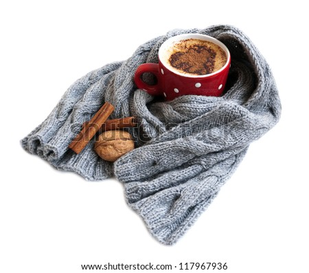 Cup of cocoa wrapped in grey scarf on a white background
