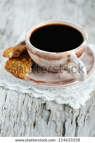Cup of coffee and broken cookie